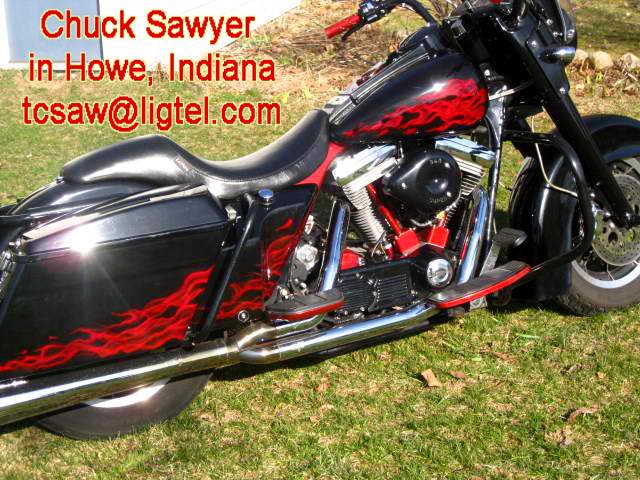 Motorcycle custom painted with red realistic flames airbrush art job by Indiana Artist Chuck Sawyer